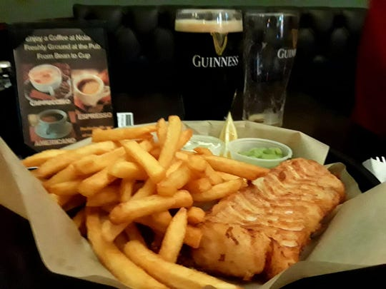 Fish and chips and soccer were the perfect combination for Kevin Fraleigh at Nolan's Irish Pub in Cocoa Beach.