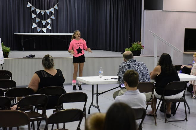 Cassandra Kurek, 13, teaches judges how to tap dance Monday during the demonstration contest at the 2019 Crawford County Fair.