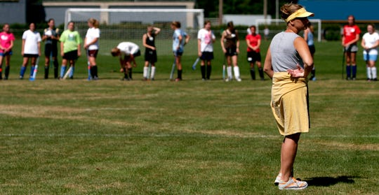 Heather Garrow watches preseason tryouts before her first season in charge of the Essex High School field hockey program in 2006.