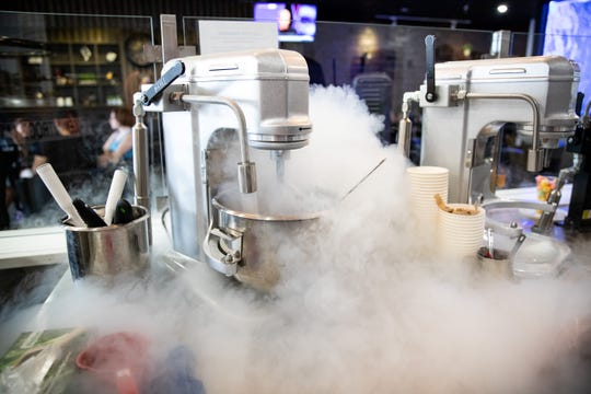 An employee at Crescendo Cafe makes Heaven's Breath and Artist Palette, a liquid nitrogen-infused dish.