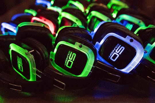 Illuminated headphones are displayed during a silent disco party at 1100 Social, located in Xfinity Live! in Philadelphia, on Friday, July 12, 2019.  A silent disco is an event where people dance while listening to music on wireless headphones.