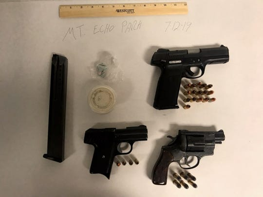 Three guns were recovered when police approached individuals they believe are connected to a recent music video.