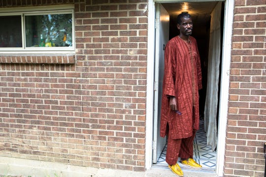 Amadou Sow, 49, a Mauritanian national, stands in the doorway of his apartment in Lockland, where his family has lived for 13 years. Immigration and Customs Enforcement arrested him Aug. 22 but inexplicably released him July 12 after almost 11 months in detention.