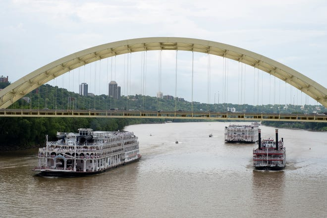 The American Queen, left, the American Duchess and BB Riverboats' Belle of Cincinnati race along the Ohio River  on Monday, July 15, 2019. This was the first time there was a race in Cincinnati since the Tall Stacks in 2006.