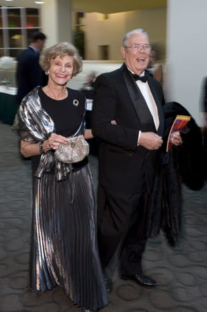 """Mary and Clyde Middleton enter the Kentucky Symphony Orchestra's """"Dance to the Music"""" gala in 2010 where Mary was an honoree."""