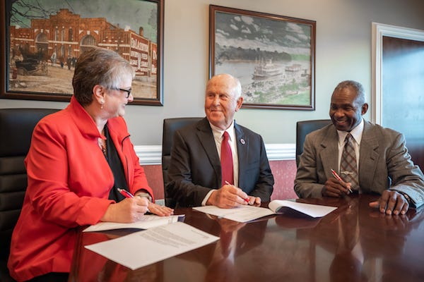 APSU President Alisa White, Billy Atkins and APSU Vice President Ronald Bailey sign paperwork to create the new scholarship.