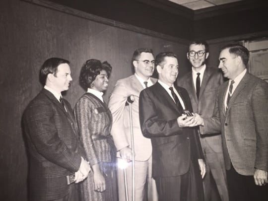Marion Lee Johnson is pictured second from the left.