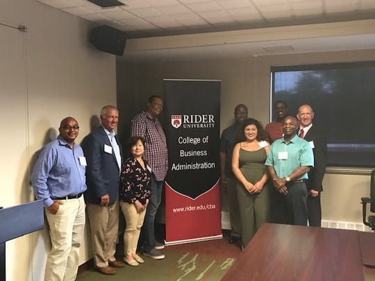 (Left to right) Dr. Mayank Jaiswal, instructor; John E. McWeeney, Jr., president and CEO, NJBankers; Elsa Negrin, Sean Smith, Ed Smith, Marissa Sarden, Darien Goens, Chase Taylor and Dr. Ronald Cook, director of Rider's Center for Entrepreneurial Studies.
