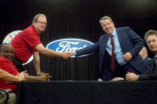 From left, Rory Gamble, UAW Vice President and National Ford Director looks on as UAW President Gary Jones shakes hands with Bill Ford, executive chairman of Ford Motor Co. beside Bill Dirksen, vice president of labor affairs at Ford during a ceremonial handshake kicking off contract negotiations at Ford World Headquarters in Dearborn on July 14.