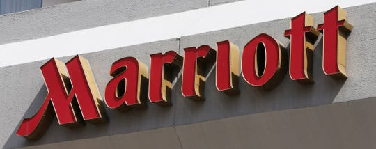 "Marriott International declined to comment on a July 2019 complaint filed by the Office of the Attorney General in the District of Columbia regarding hidden ""resort fees."" This March 23, 2016 shows a sign at a Marriott Hotel in Richmond, Va. (AP Photo/Steve Helber, File)"