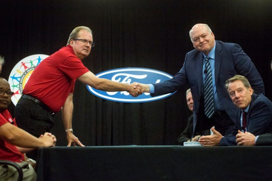 From left, Rory Gamble, UAW Vice President and National Ford Director looks on as United Auto Workers (UAW) union President Gary Jones shakes hands with Ford President and CEO Jim Hackett beside Bill Ford, executive chairman of Ford Motor Co. during the Ford UAW contract ceremonial handshake at Ford World Headquarters in Dearborn, Monday,  July 14th, 2019.