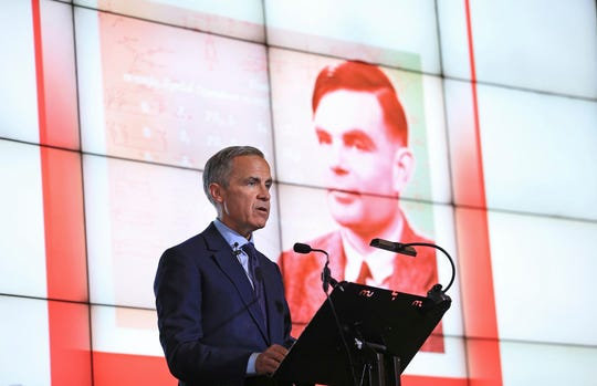 Governor of the Bank of England, Mark Carney speaks, during the announcement that Second World War code-breaker Alan Turing has been selected to feature on the new 50 pound notes, at the Science and Industry Museum, in Manchester, England, Monday July 15, 2019.
