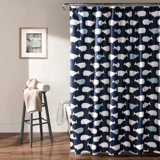 A shower curtain with a beachy feel can make your space reminiscent of an outdoor setting.