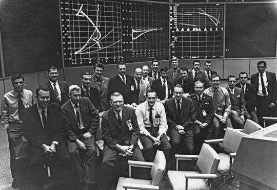 Flight Activities Officer Spencer Gardner, first row fourth from right, with members of the Apollo 11 White Team in the Mission Operation Control Room in Houston shortly after the mission in July 1969.