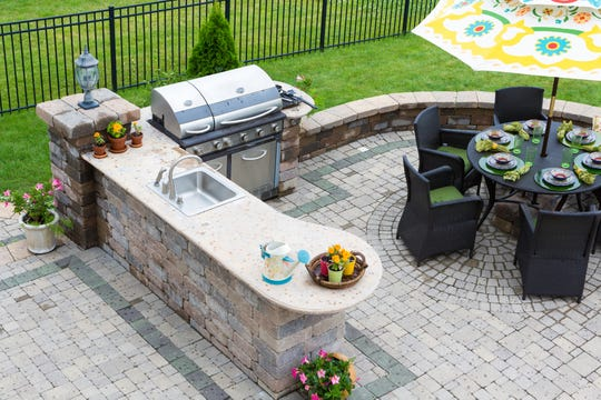 An outdoor kitchen and grill can create a luxurious entertaining space, but maintain and clean them properly to ensure many years of usable life.