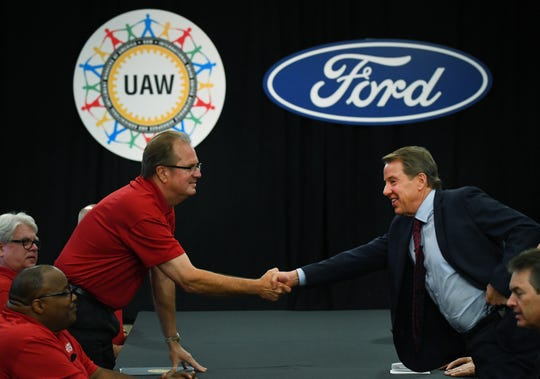 United Auto Workers President Gary Jones, left, and Ford Executive Chairman Bill Ford Jr. shake hands to open contract negotiations in 2018 at Ford headquarters.
