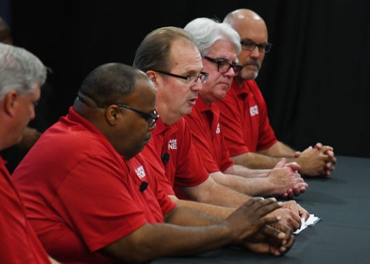 UAW President Gary Jones, center, and the UAW negotiating team open contract negotiations with Ford Motor Co.