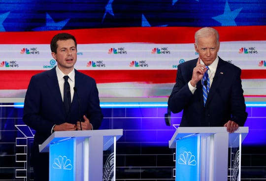 Democratic presidential candidate South Bend Mayor Pete Buttigieg, left, speaks as former vice president Joe Biden gestures during the Democratic primary debate hosted by NBC News at the Adrienne Arsht Center for the Performing Art in Miami on  June 27, 2019.