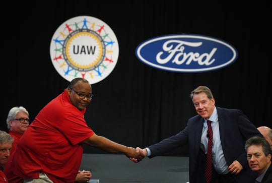 United Auto Workers Vice President Rory Gamble, left, and Ford Motor Co.'s executive chairman, Bill Ford, open national contract talks between the union and the automaker.