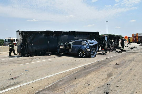 Authorities say a woman and her 18-month-old twin daughters died in the fiery, seven-vehicle crash on an Indianapolis freeway.