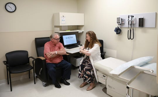 IDr. Jori Fleisher, neurologist, examines Thomas Doyle, 66, at the Rush University Medical Center in Chicago. Doyle, 66, hopes blood tests may someday replace the invasive diagnostic testing he endured to be diagnosed 4.5 years ago with Lewy body dementia.