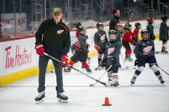 Red Wings defenseman Dennis Cholowski keeps an eye on the players while working as a guest instructor during a youth hockey camp at Little Caesars Arena on Monday.