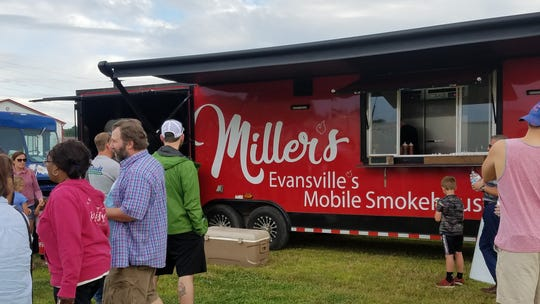 Miller's Barbecue and Catering Mobile Smokehouse serving customers at Farm 57 in June, 2019.