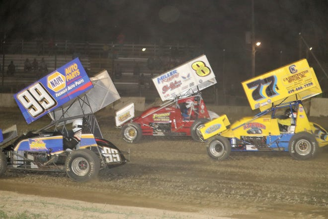 Alvin Roepke, left, Bobby Clark, center, and John Ivy battle for the lead in the 305 A-main Saturday at Fremont Speedway.