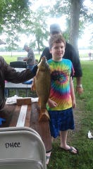 Colton Clark and a catch of the day at the Oak Harbor Conservation Club.
