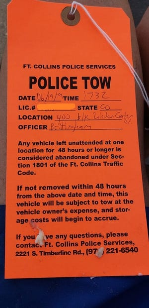 Fort Collins police issued this tow notice to 11 vehicles parked on Linden Center Drive.