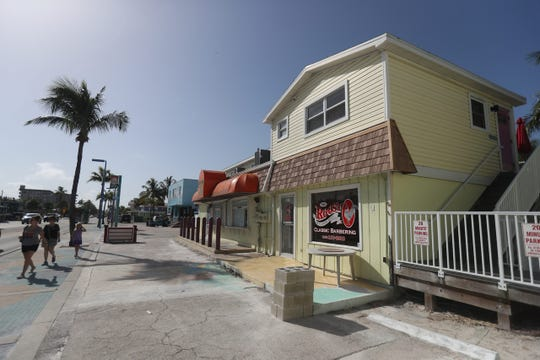 Some of the businesses owned by TPI Hospitality on Fort Myers Beach. The spaces are being torn down or renovated to make room for the Margaritaville Resort being built by TPI Hospitality. Multiple businesses affected have to be out of their spaces by the beginning of January.