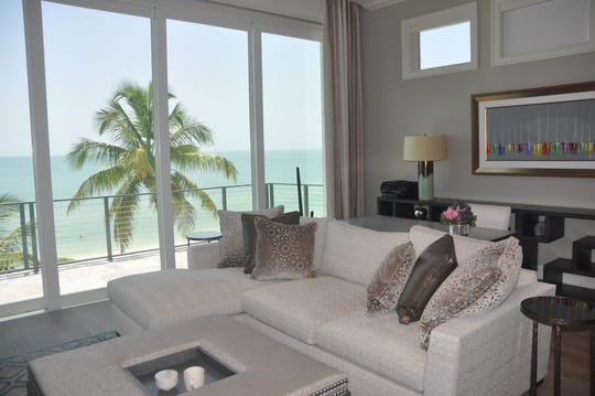 The third floor has a den/bonus room with a wall of sliders that lead to a terrace overlooking the Gulf.