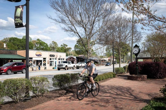 A cyclist travels down the Swamp Rabbit Trail on South Main Street in Travelers Rest April 11.   MATT BURKHARTT/greenville news A cyclist travels down the Swamp Rabbit Trail on South Main Street in Travelers Rest Apr. 11, 2019.