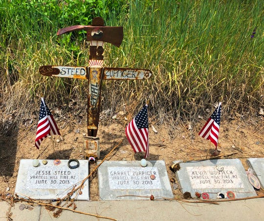 This June 3, 2019 photo shows memorial stones at the Wildland Firefighters Monument at the National Interagency Fire Center in Boise, Idaho, for wildland firefighters killed by a wildfire on June 30, 2013, near Yarnell, Ariz. Federal officials at the NIFC are bolstering mental health resources for wildland firefighters following an apparent increase in suicides.