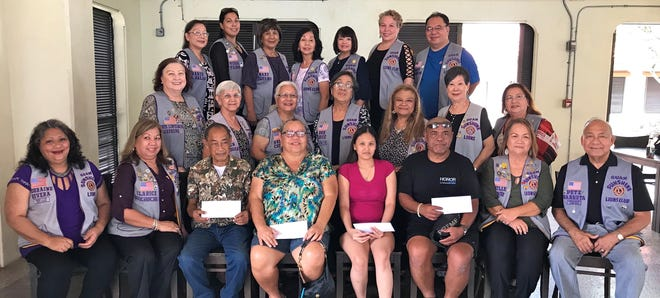 The Guam Sunshine Lions Club presented monetary donations to four individuals to assist with their medical treatment expenses on June 8 at the Chamorro Village.  Recipients are:  (seated) Felix B. Babauta, 77, of Agat, Rita S. Mendiola, 65, of Agat, Prorena Valeriano, 28, of Dededo, and Anthony Cruz, 50, of Yigo.