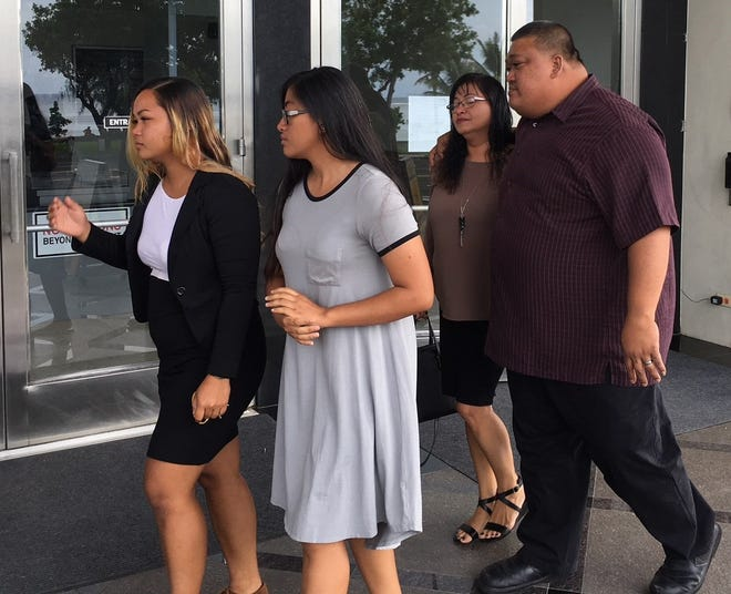 Ricky Q. Sanchez, right, a former supervisor at Guam Homeland Security, leaves the U.S. District Court of Guam  Monday afternoon, along with family members, after being sentenced to 30 months for a drug crime.