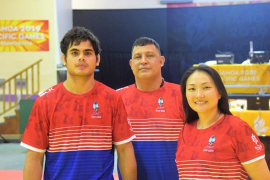 Guam's judoka at the Pacific Games are Joshter Andrew, left and Amy Cho, right. The two will compete in the -81 kg and -63 kg divisions, respectively. At center is judo coach Frank Arriola.