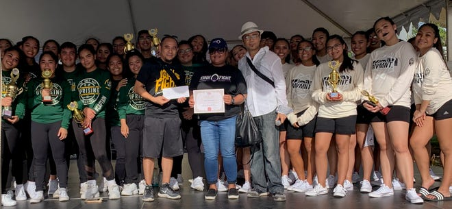 The Guam Allied Dance Force hosted the eight annual Island-wide D.O.E. dance team competition at Chamorro Village, in partnership with Sanctuary Guam Inc. Youth Festival. Guam Cancer Care is this year's Guam Allied Dance Force beneficiary. Guam ADF Director C'zer Medina and the delegates from JFKHS and SSHS presented certificate, ADF shirts, and a monetary donation to Guam Cancer Care Lay Navigator George Prudente and Director of Guam Cancer Care Ellie Ongrung.