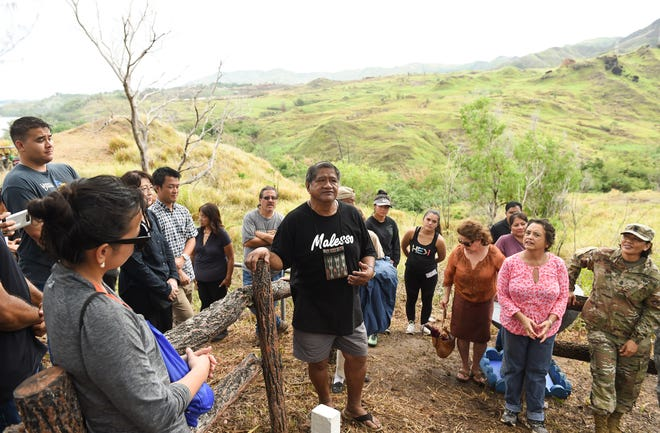 Merizo Mayor Ernest T. Chargualaf shares some history on the Faha massacre during an annual visit in Merizo in this July 2019 file photo.