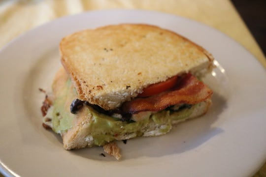 The Whole farm sandwich on the lunch menu comes with all natural, antibiotic free chicken breast cooked with herbs, bacon, Colby cheese, lettuce, baby spinach, tomato, red onion, and our fresh avocado spread served on white bread.