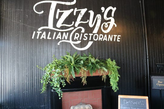 """Izzy's Italian Ristorante"" is painted on the wall in the entrance of the new restaurant."
