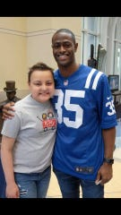 Madi Moore, left, is shown with Indianapolis Colts cornerback Pierre Desir the day she announced the team's draft picks.
