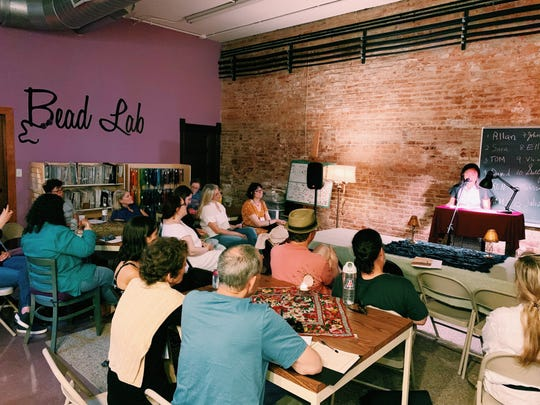 Festival attendees during an open mic at Beadology.