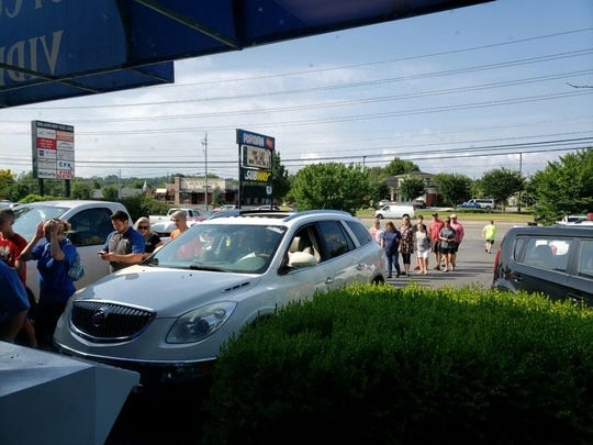 Customers waiting to purchase discounted movies at Popcorn Video on Friday, July 12. Manager Matt Scull said he was surprised with the amount people outside when the store opened at 10 a.m.