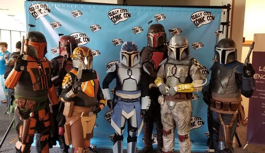 "The ""Tra'cor Clan Mandalorian Mercs of Michigan,"" based on ""Star Wars"" character Boba Fett, at the 2018 edition of Really Cool Comic Con in Hartland. The event returns Saturday July 20 at the Hartland Community Center at 9525 E. Highland Road."