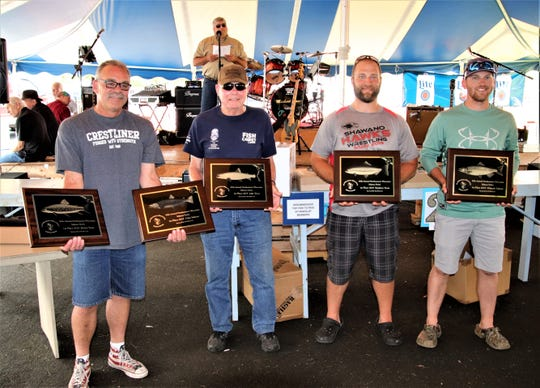 Winners in each of the five fish categories holding their plaques at the 2019 Northeastern Wisconsin Great Lakes Sport Fishing Salmon Derby (from left): Joe Sharpe, first-place brown trout and Coho salmon; Ed Wolfert, first-place lake trout; Mike Homan, first-place rainbow trout; and Eric Berg, first-place Chinook salmon.
