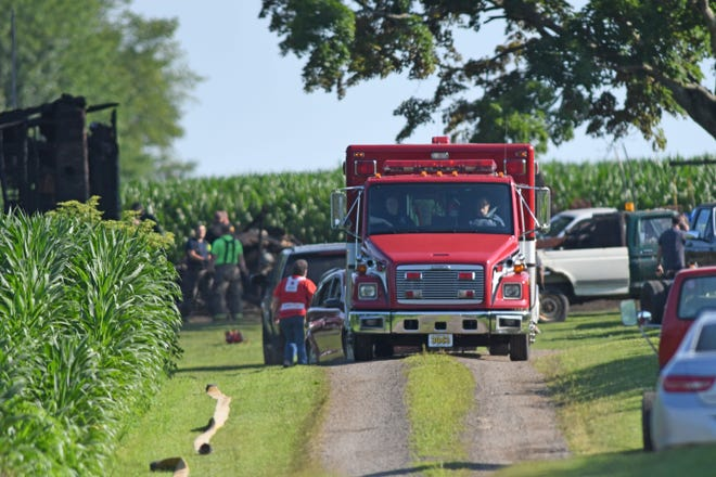 A Jeromesville Fire and Rescue vehicle leaves the scene of a fatal fire Monday morning. Three children died early Monday in a house fire at 234 Township Road 1550 in Ashland County, north or Jeromesville.