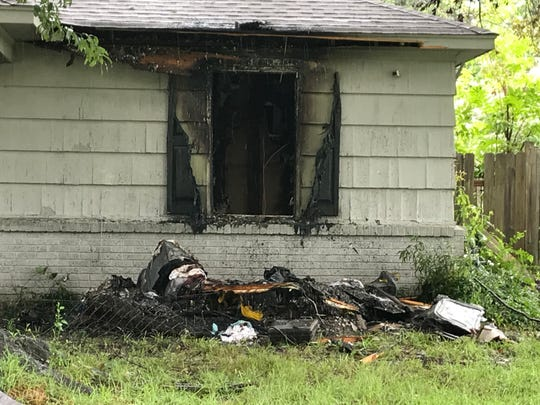 Leftover remains of a home that burned as a result of a house fire on Monday morning.