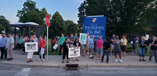 "People lined the streets with signs on July 12 in Wauwatosa for ""Lights for Liberty"" rally and vigil, one of more than 700 that were planned across five continents to raise awareness of conditions in immigrant detention facilities in the southern United States."