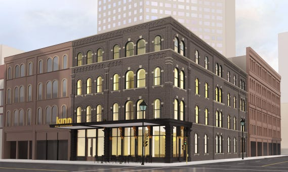 A hotel proposed for a downtown historic building has again been downsized with hopes of winning city approval.